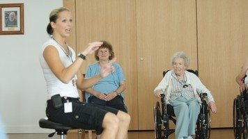 Female activity coordinator with seniors.