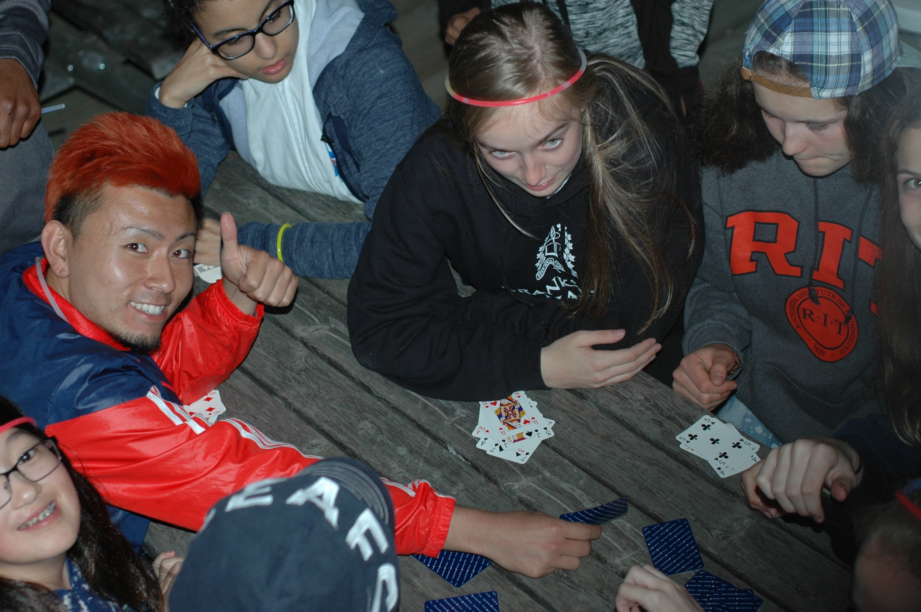 Campers playing cards.