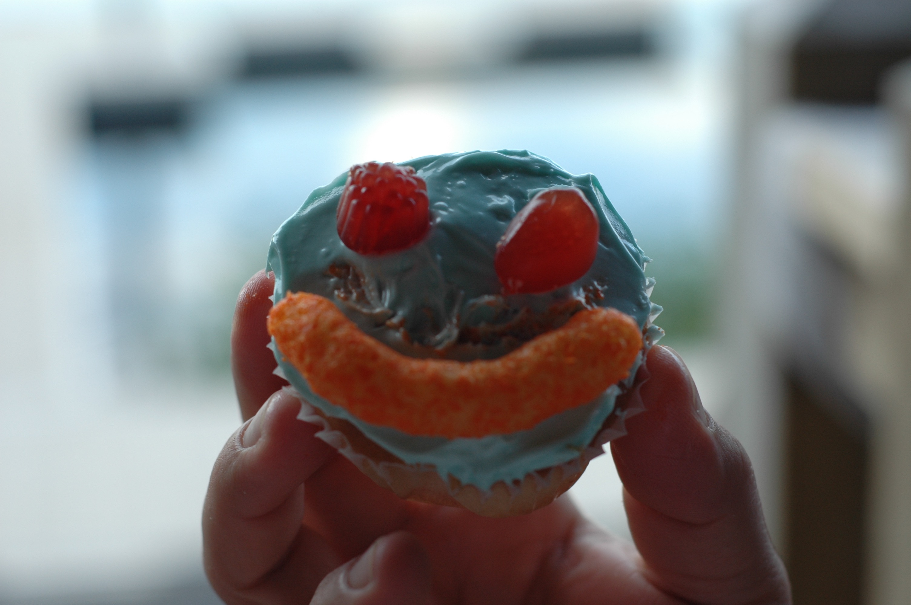Camper makes their own cupcake.
